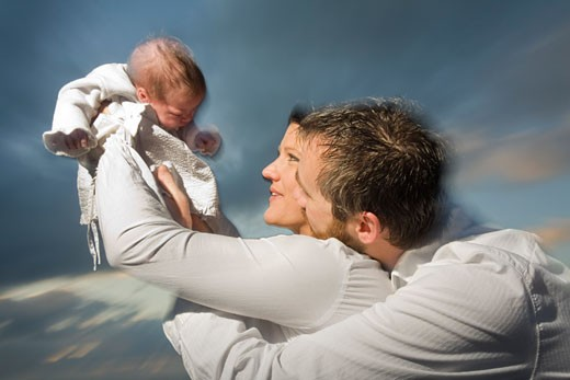 Stock Photo: 1828R-43453 Parents with Newborn