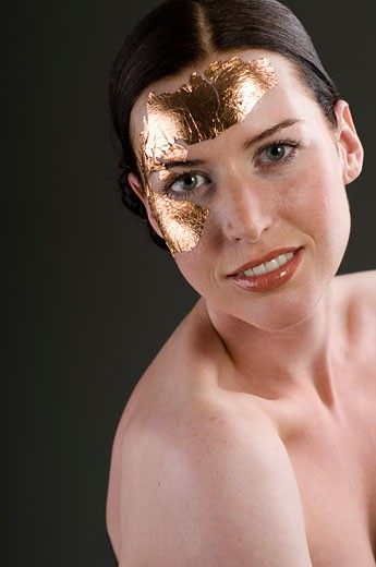 Woman with Gold Leaf on Face    : Stock Photo