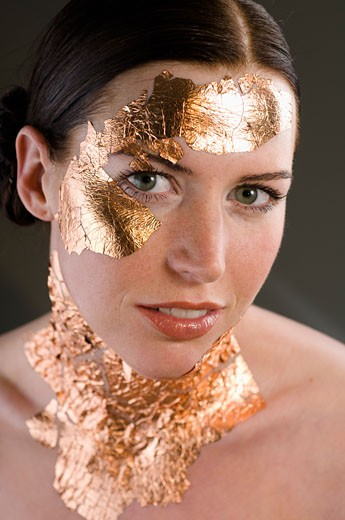 Woman with Gold Leaf on Skin    : Stock Photo