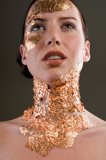 Woman with Gold Leaf on Face and Neck    : Stock Photo