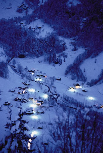 Overveiw of Houses and Trees from Mountain at Night in Winter Switzerland    : Stock Photo