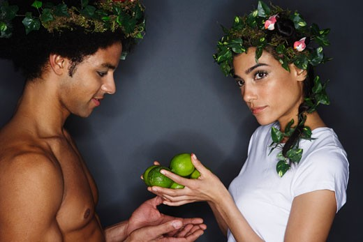 Stock Photo: 1828R-44223 Couple With Wreaths in Hair, Holding Limes
