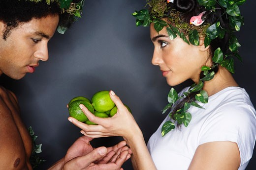 Stock Photo: 1828R-44224 Couple With Wreaths in Hair, Holding Limes