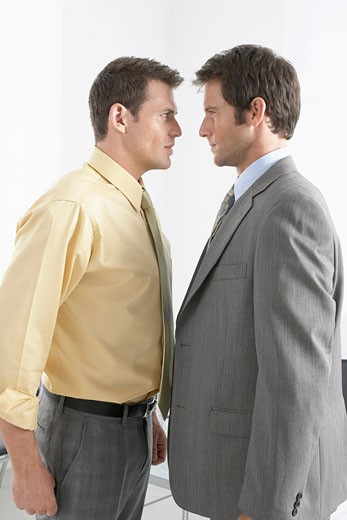 Stock Photo: 1828R-44494 Businessmen Fighting