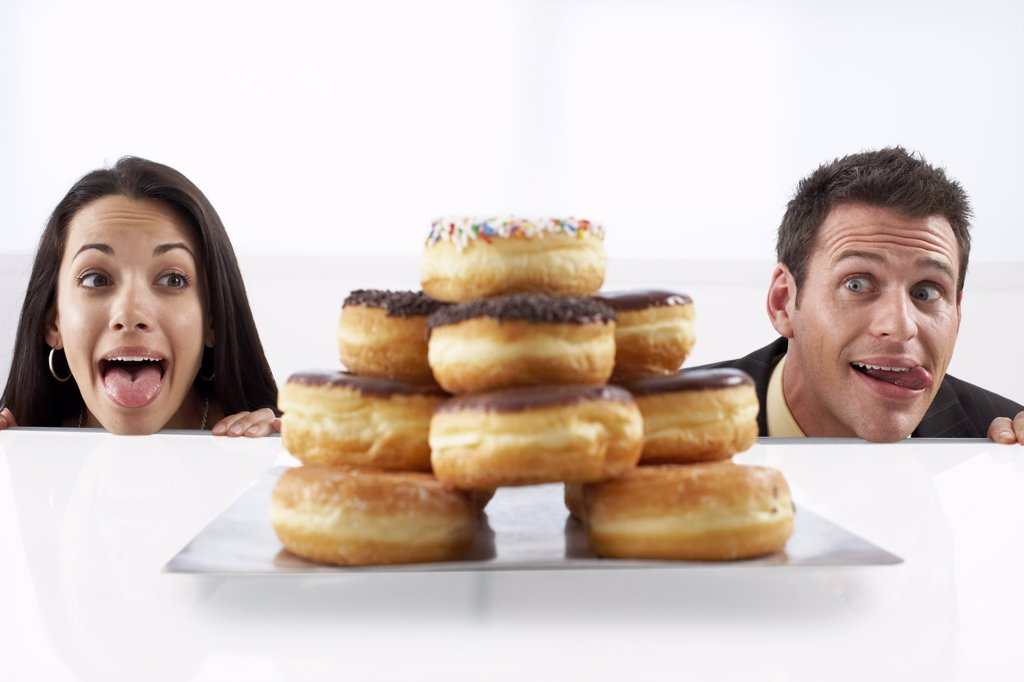 People Stalking Doughnuts    : Stock Photo