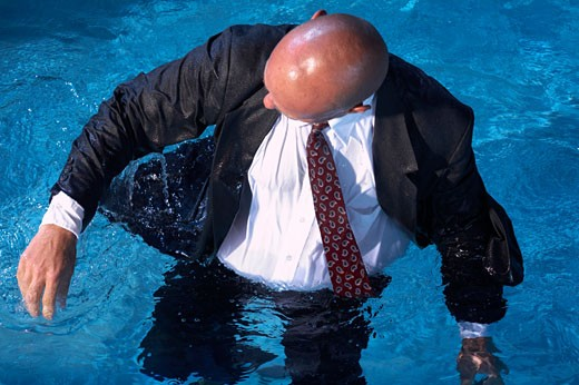 Businessman in Swimming Pool    : Stock Photo