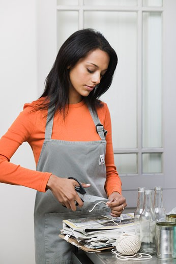 Stock Photo: 1828R-45379 Woman Bundling Recycling
