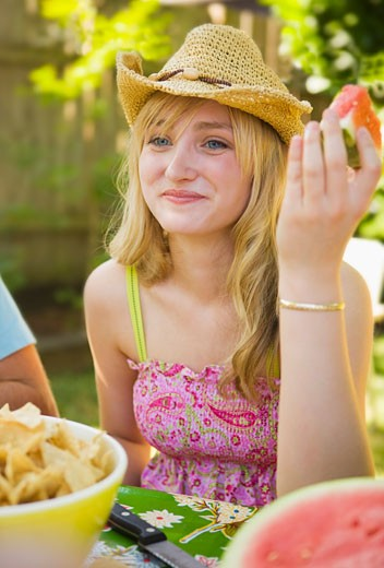 Woman Eating Watermelon, Portland, Oregon, USA    : Stock Photo