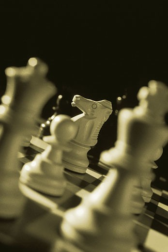 Close-Up of Chess Pieces on Chess Board    : Stock Photo