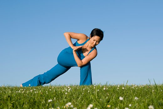 Woman Practicing Yoga    : Stock Photo
