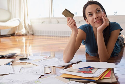Stock Photo: 1828R-45904 Woman Holding Credit Card