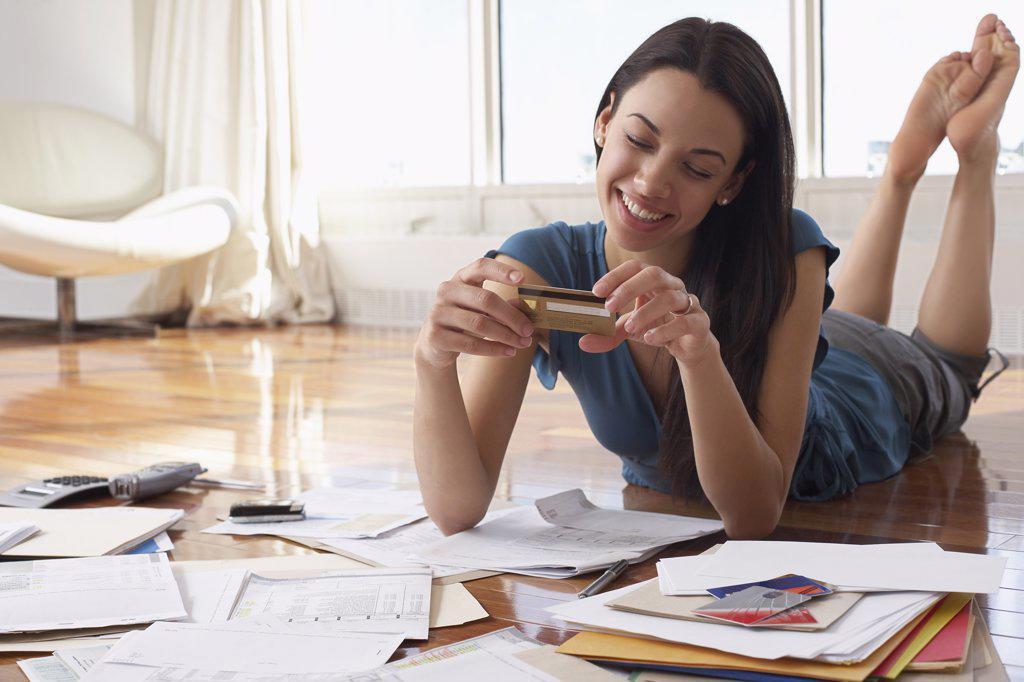 Woman Looking at Credit Card    : Stock Photo