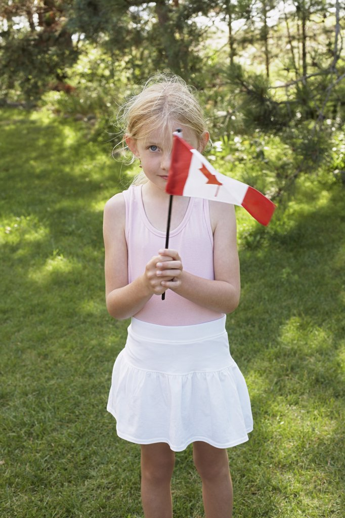 Stock Photo: 1828R-46120 Portrait of Little Girl Holding Canadian Flag, Elmvale, Ontario, Canada