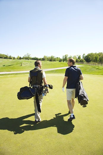 Stock Photo: 1828R-46291 Golfers on Putting Green
