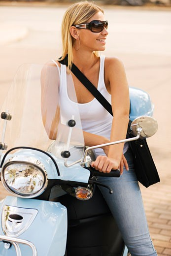 Stock Photo: 1828R-46300 Woman on Motor Scooter