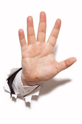 Stock Photo: 1828R-46383 Businessman's Hand Bursting Through a Wall