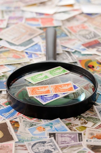 Stock Photo: 1828R-46567 Magnifying Glass and Stamp Collection