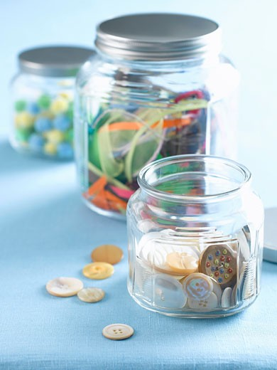 Stock Photo: 1828R-46680 Jars of Buttons, Ribbon and Pom Poms