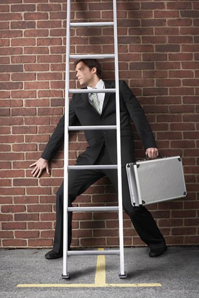 Stock Photo: 1828R-46710 Businessman Walking Under Ladder