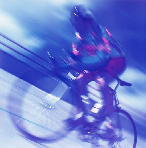 Blurred View of Person Riding Bicycle    : Stock Photo