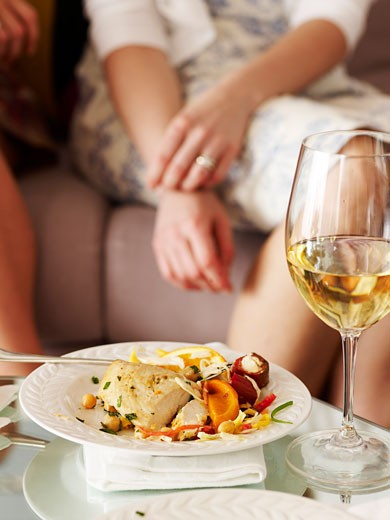 Stock Photo: 1828R-47136 Women with Dinner and Wine