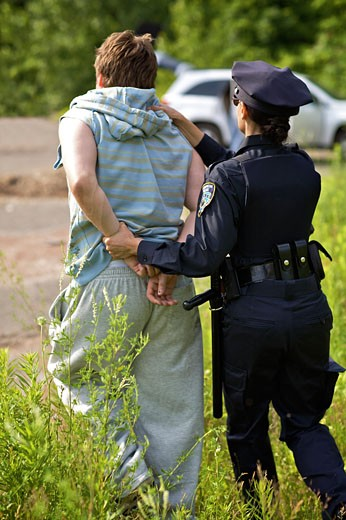 Police Officer Arresting Suspect    : Stock Photo