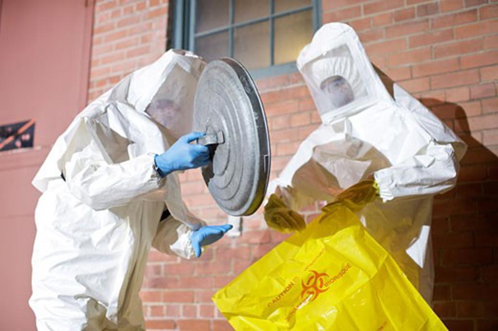 Stock Photo: 1828R-47519 Workers in Hazmat Suits