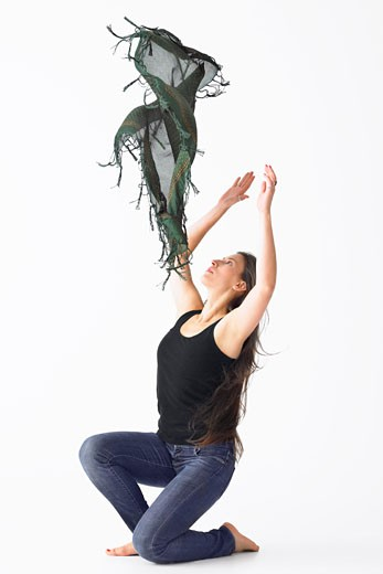Stock Photo: 1828R-47778 Woman Tossing Shawl in Air while Dancing