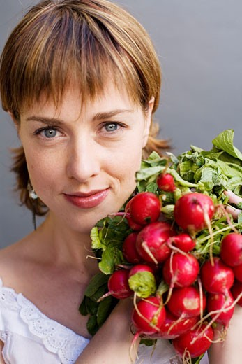 Stock Photo: 1828R-47794 Woman Holding Radishes