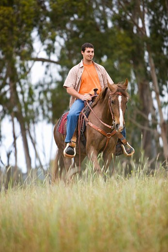 Stock Photo: 1828R-47920 Man Horseback Riding on Ranch, Santa Cruz, California, USA