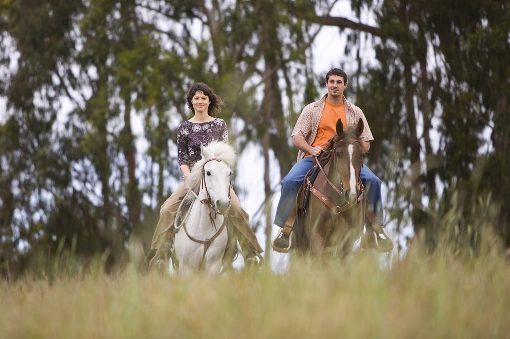 Couple Horseback Riding on Ranch, Santa Cruz, California, USA    : Stock Photo
