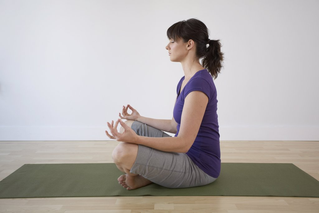 Stock Photo: 1828R-48385 Woman Meditating in Lotus Pose