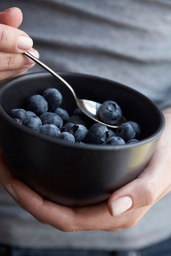 Stock Photo: 1828R-48460 Person Holding Bowl of Blueberries