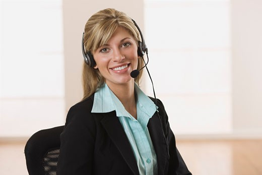 Stock Photo: 1828R-49048 Portrait of Businesswoman in Office Talking on Headset