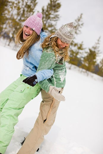 Stock Photo: 1828R-49403 Two Women Playing in the Snow, Near Frisco, Summit County, Colorado, USA