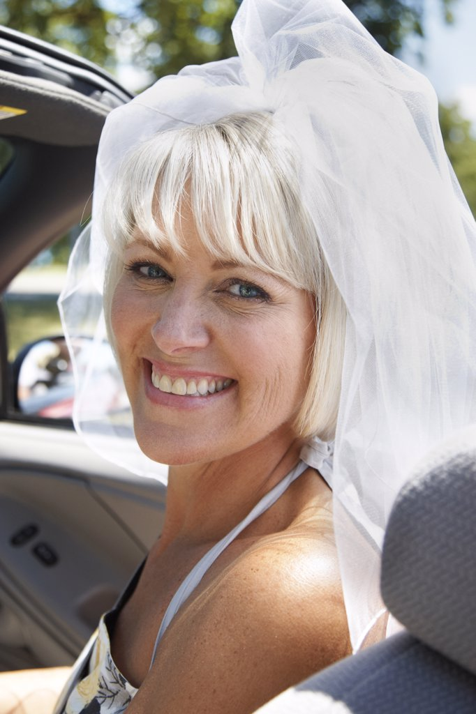 Bride in Convertible    : Stock Photo