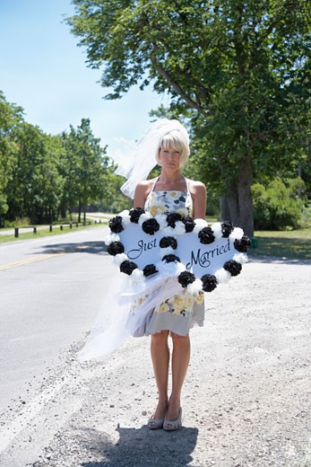 Woman Holding Just Married Sign by Side of Road, Niagara Falls, Canada    : Stock Photo