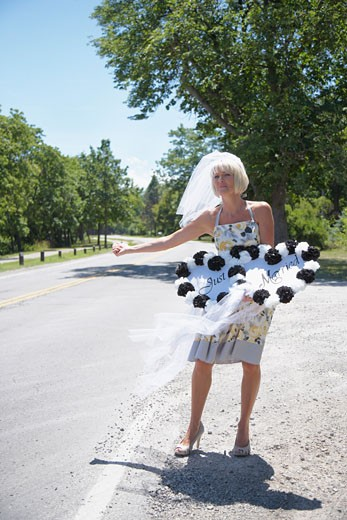 Stock Photo: 1828R-49758 Bride Hitchhiking, Niagara Falls, Canada