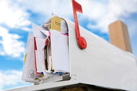 Stock Photo: 1828R-49799 Full Mailbox