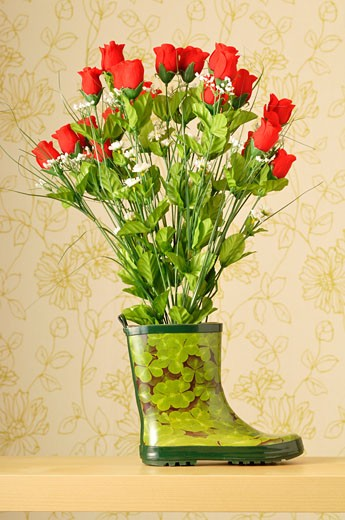 Stock Photo: 1828R-49923 Bouquet of Roses in Rubber Boot