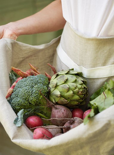 Woman Holding Apron of Vegetables : Stock Photo
