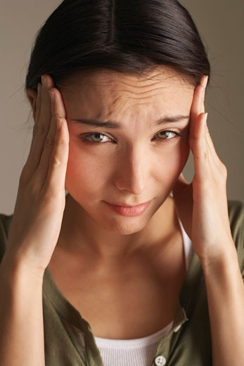 Stock Photo: 1828R-50317 Woman With Headache