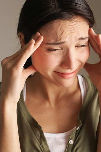 Stock Photo: 1828R-50318 Woman With Headache