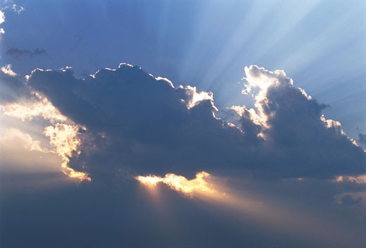 Stock Photo: 1828R-5040 Sunrays through Clouds in Sky