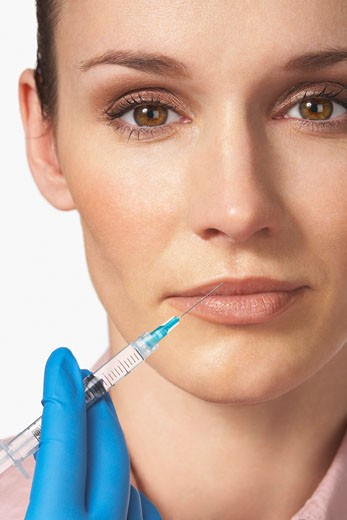 Stock Photo: 1828R-50443 Woman Getting Botox Injection