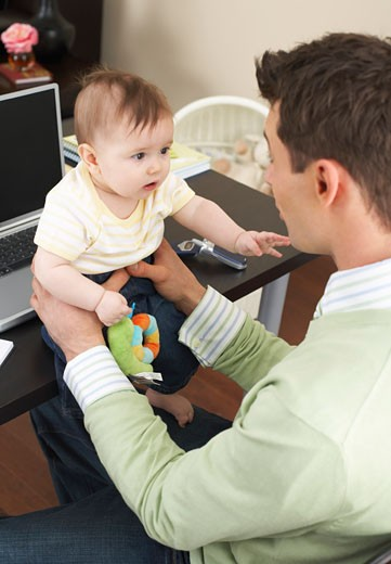 Stock Photo: 1828R-50561 Father with Baby