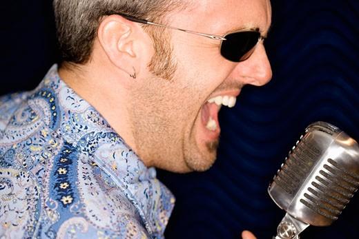 Stock Photo: 1828R-50866 Portrait of Man Singing