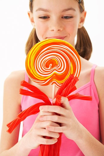 Stock Photo: 1828R-51228 Girl Holding Licorice and large Lollipop