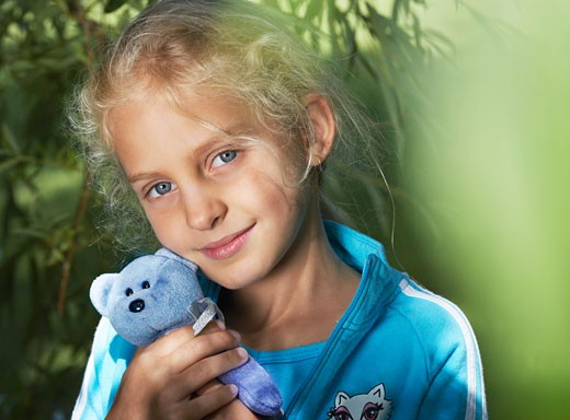 Stock Photo: 1828R-51521 Portrait of Girl Outdoors
