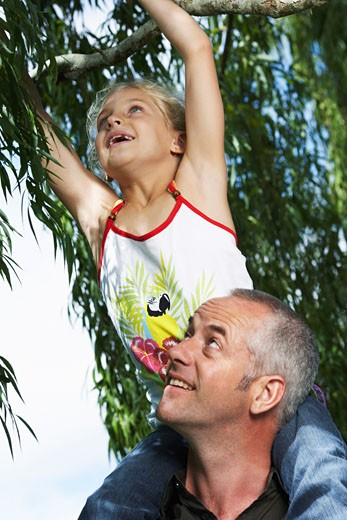 Stock Photo: 1828R-51532 Father and Daughter Outdoors